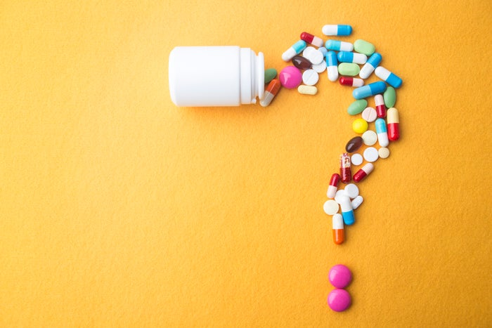 Medical drugs forming a question mark.