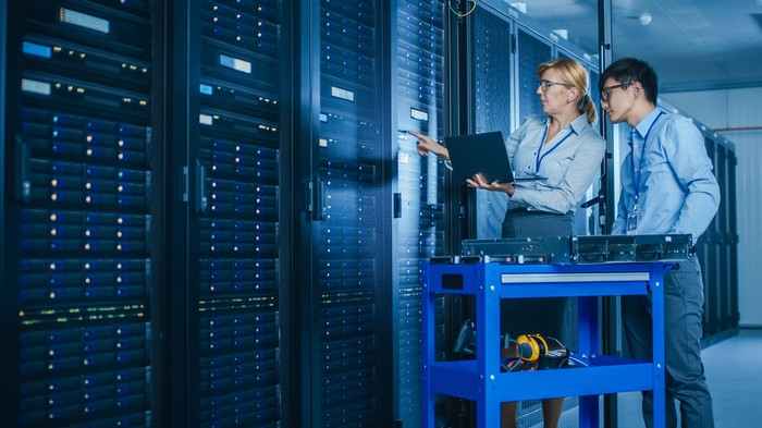 Two workers at a data center.