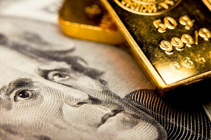 Gold bars on a twenty-dollar bill.