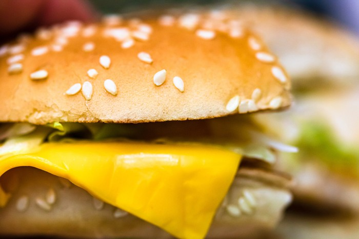 closeup of cheeseburger on sesame seed bun