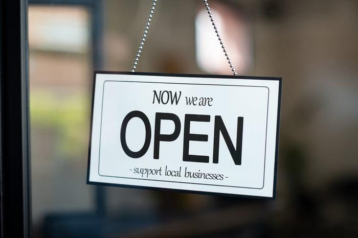 Open sign in a shop window.