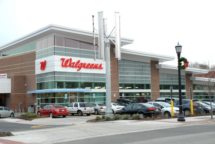 Exterior of a Walgreens store with cars in the parking lot