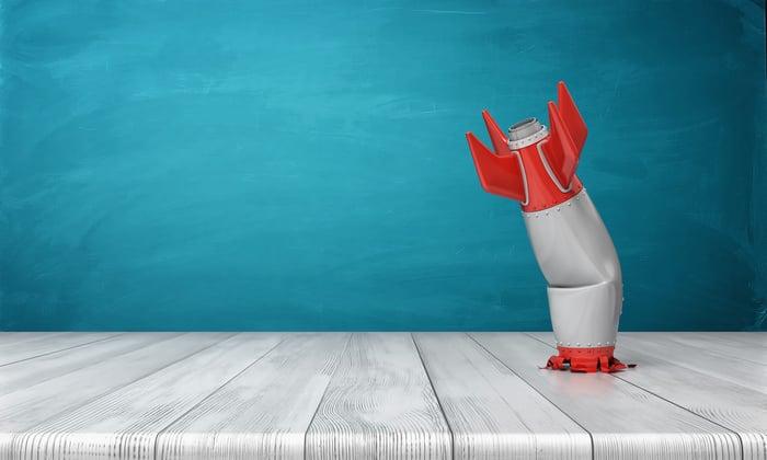 A toy rocket crashed into a desk.