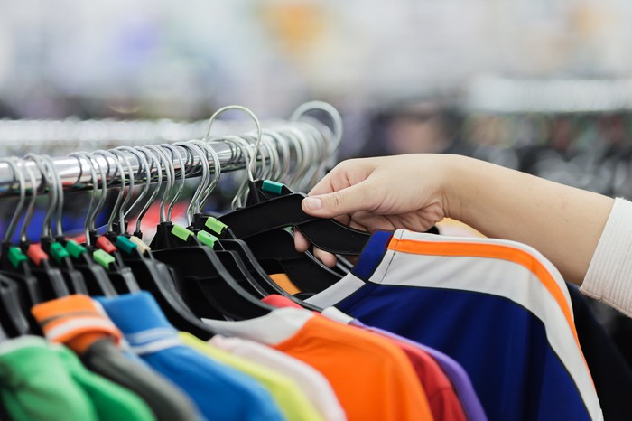 A shopper checking  out Activewear shirts.