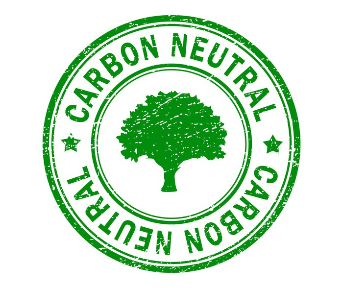 """Carbon Neutral"" green seal with a tree in the center."
