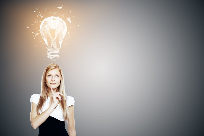 Light bulb going on over smiling woman's head.