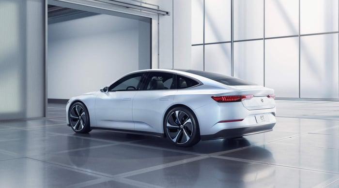 A white NIO ET7, a sleek electric luxury-sports sedan.