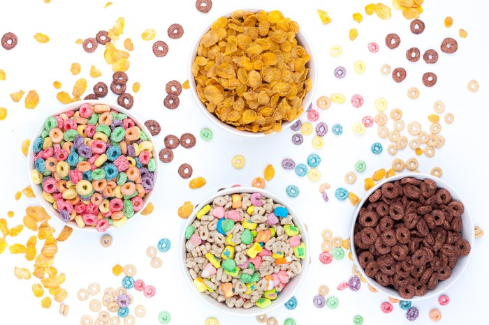 overhead view of four bowls of kids cereals