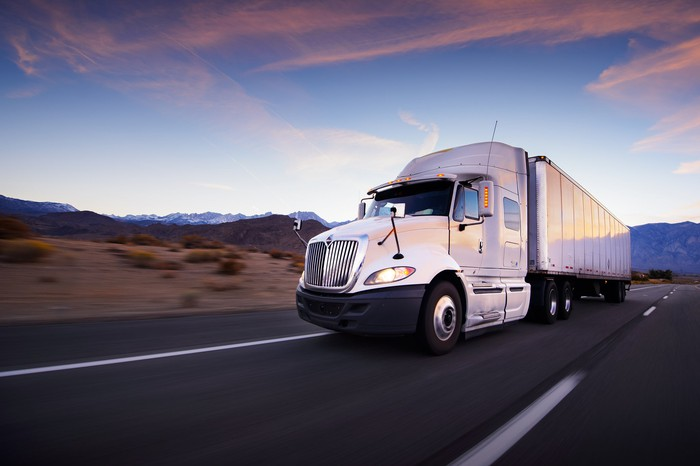 A truck driving on the open road.