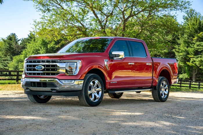 A red 2021 Ford F-150, a full-size pickup truck.