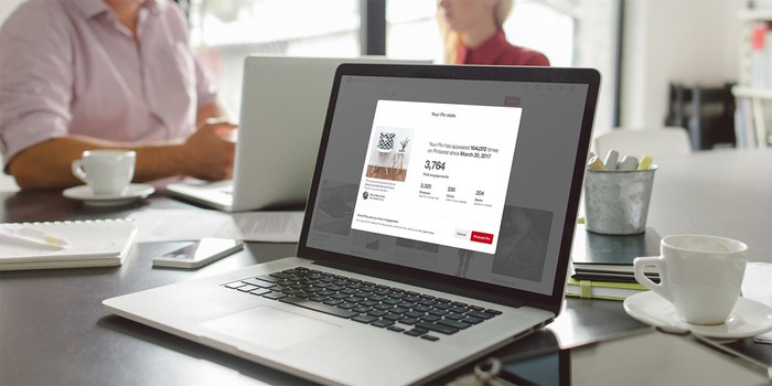 A Pinterest website page open on a laptop located on a dining table.