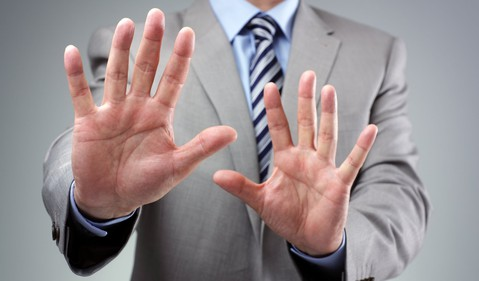 Businessman Holding Hands Up Stop Avoid Getty