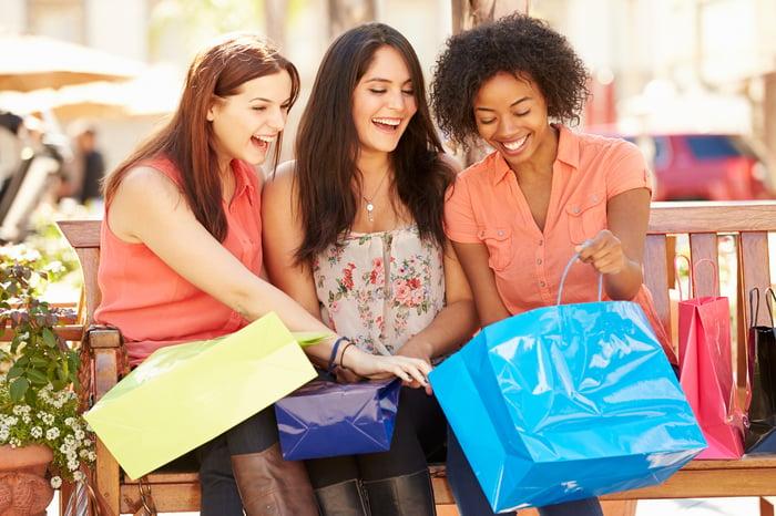 Three young women shopping.
