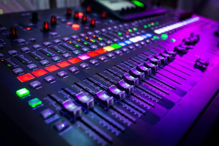a close up image of a music mixer