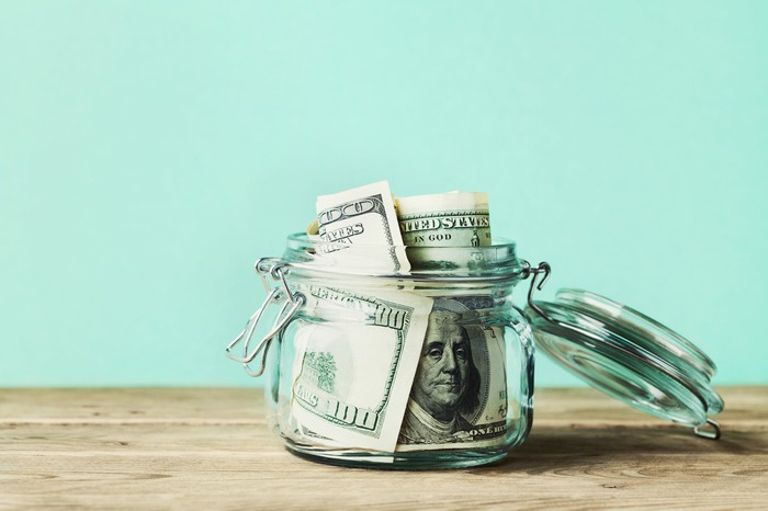 A jar filled with cash.