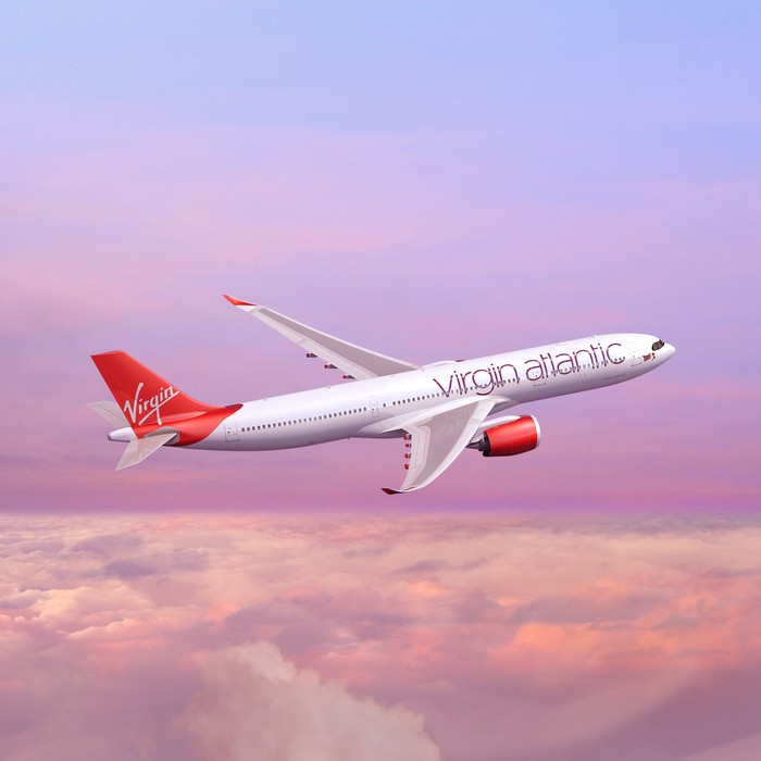 A Virgin Atlantic A330 flying above the clouds.