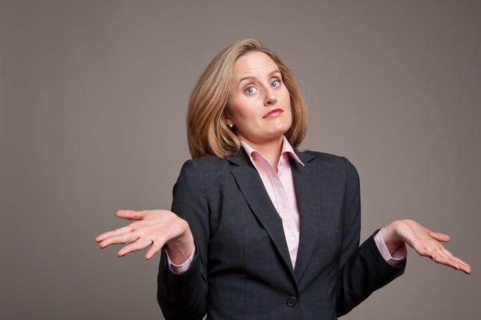 A businesswoman shrugs.