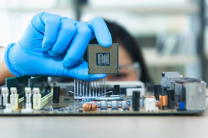 An engineer works on a microchip.