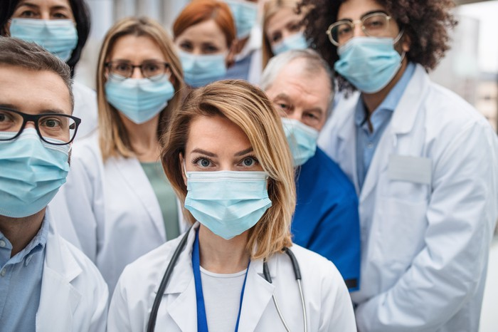Group of doctors with face masks looking at camera