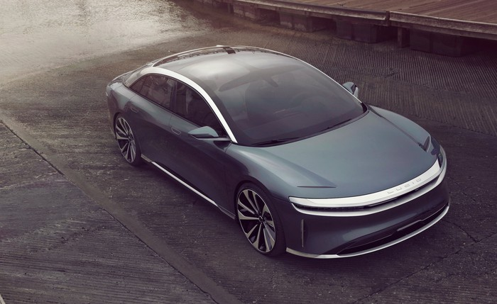 A gray Lucid Air, a sleek full-size electric luxury sedan.