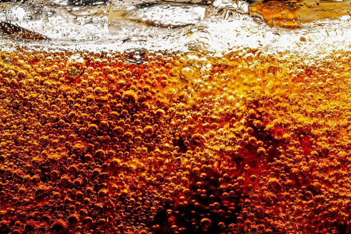 close up of bubbles in carbonated cola