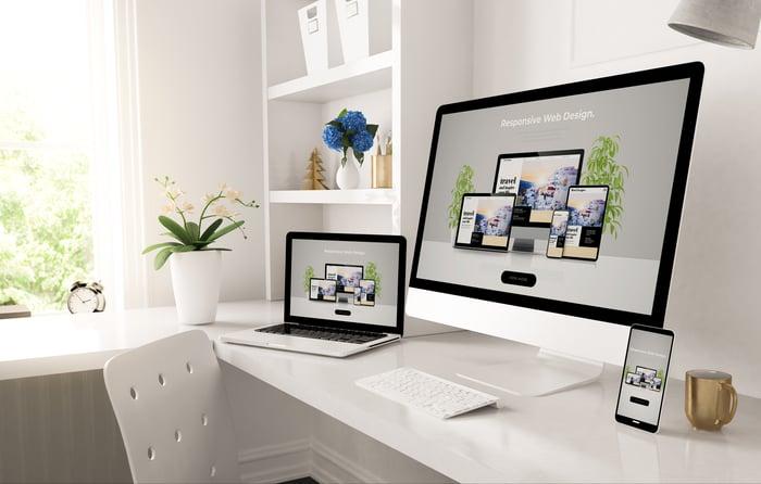 Website design tools displayed on a desktop computer, laptop, and mobile phone.
