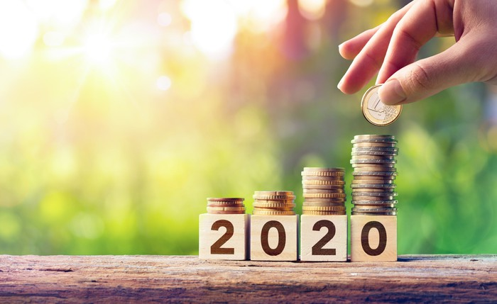 Four columns of coins growing as 2020 is spelled out in blocks.