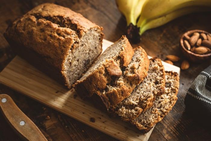A loaf of bread on a cutting board.