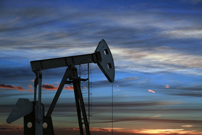 An oil pump at twilight.