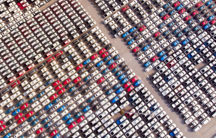A parking lot at a car dealership filled with cars.