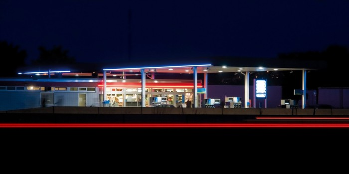 A gas station at night.