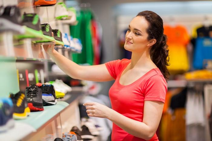 Woman looking at sneakers on display