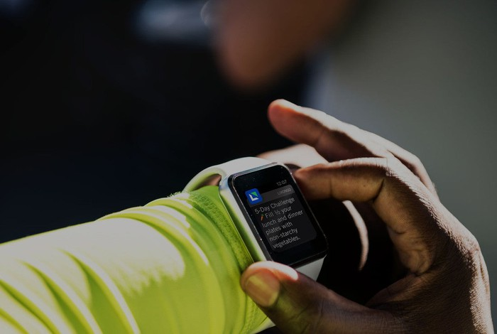 A smartwatch showing a notification from Livongo.
