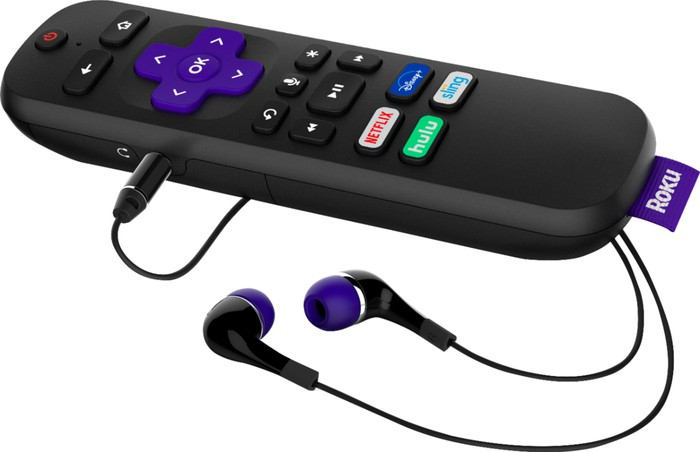 A Roku streaming stick with headphones plugged in