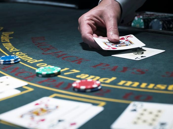 Blackjack game in progress at a casino.
