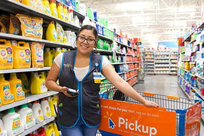 Walmart associate with a pickup wagon.
