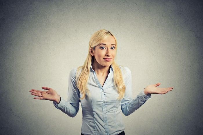 Confused woman shrugging