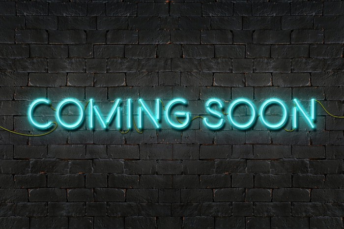 A neon sign that says coming soon
