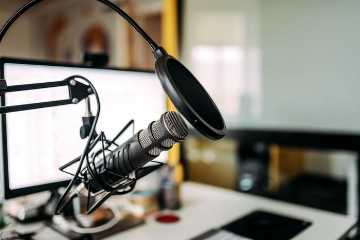 A microphone boom in a radio studio