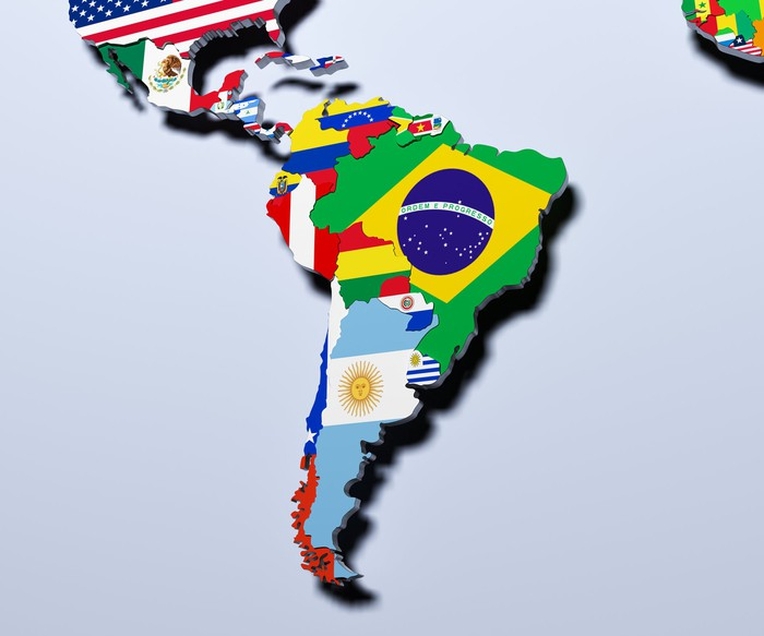 Latin American map with the country's flag overlaid in each country.