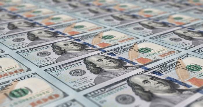 A sheet of $100 bills fresh of the printing press.