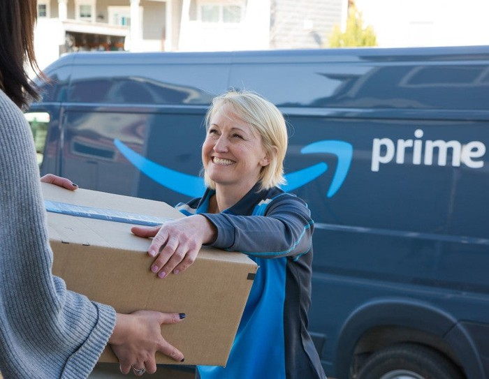 Amazon van driver delivering package