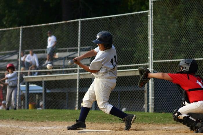Batter swinging at a baseball