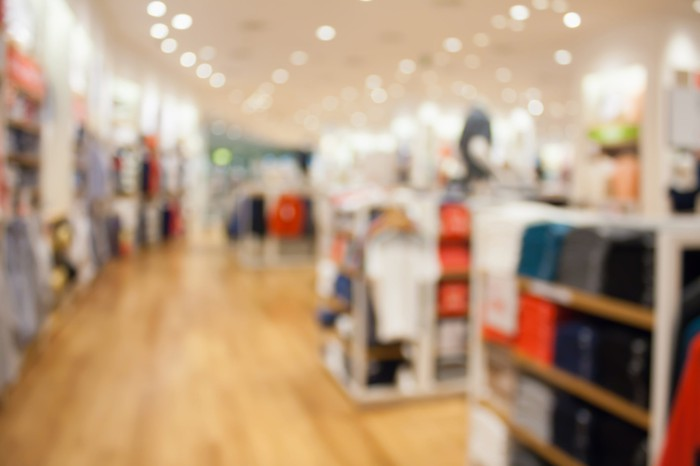 A blurry image of a department store shopping floor