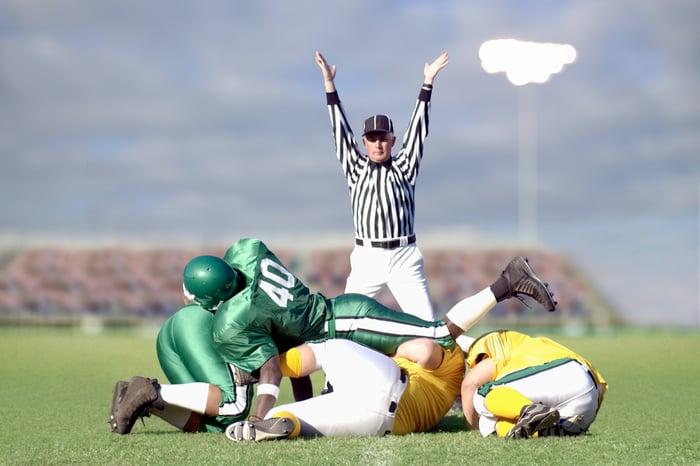 Football referee signaling a touchdown
