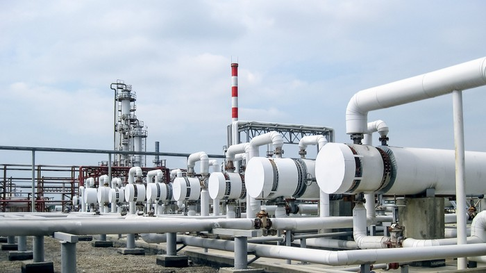 Oil gathering and processing pipes at a plant.
