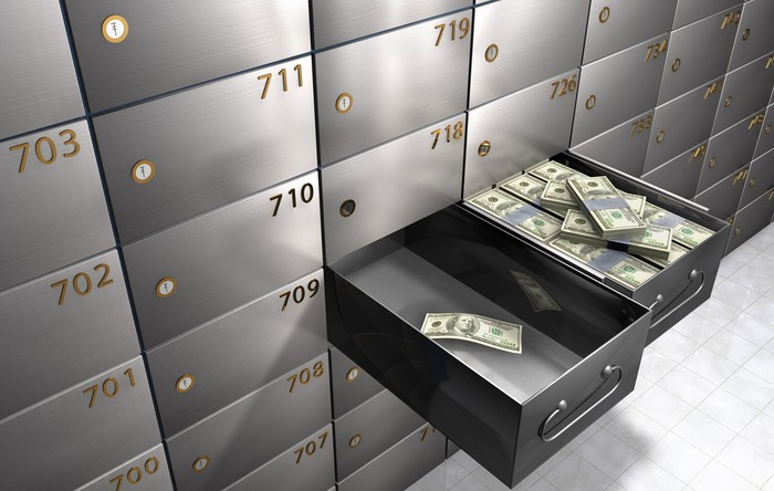 two safe deposit boxes with different levels of cash
