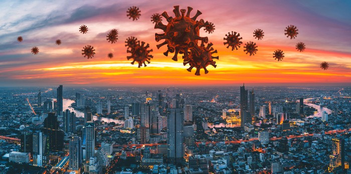 Coronavirus microbes hovering over a city