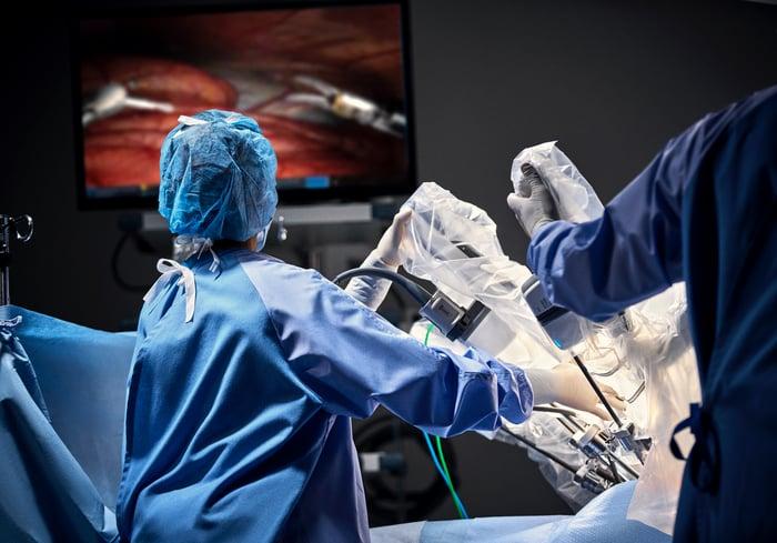 Surgeons using Intuitive Surgical da Vinci robotic surgical system.