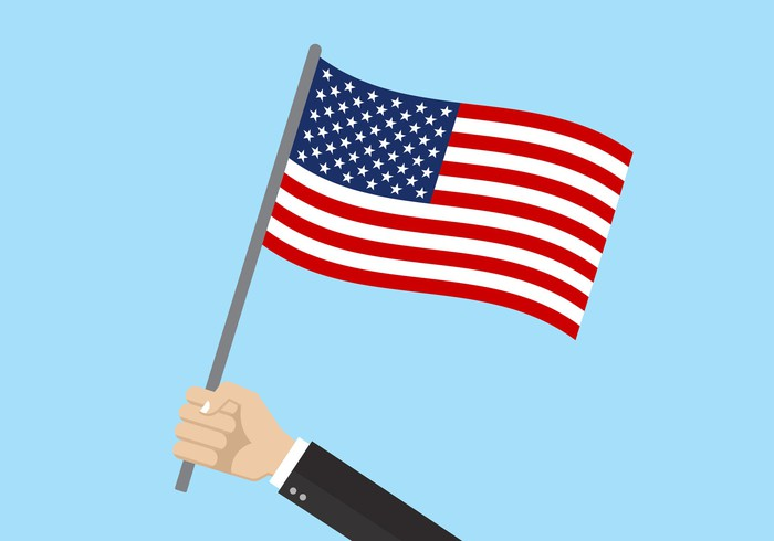 Person holding an American flag.